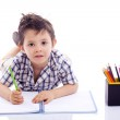 Schoolboy drawing with colored pencils — Stock Photo #48453711
