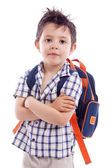 Portrait of school kid standing with arms crossed — Stock Photo