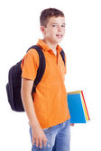 Portrait of a school boy with backpack holding notebooks, isolat — Stock Photo