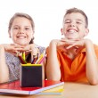 Portrait of two school kids at the desk, isolated on white backg — Stock Photo #48859453