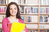 Happy female student holding books — Stock Photo