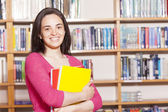 Female student holding books — Stock Photo