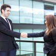 Business partners shaking hands in meeting hall — Stock Photo #49612481