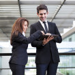Smiling business partners working with electronic tablet at mode — Stock Photo #49612515