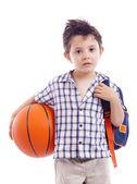 School kid holding a basket ball — Stock Photo