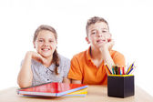 Two school kids at desk — Stock Photo