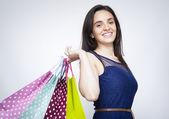 Jeune femme avec des sacs à provisions — Photo