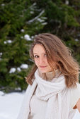 Smiling Caucasian Young Woman posing in Snowy Winter — Stock Photo