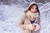 Winter woman outside on snowing cold winter day. — Stock Photo