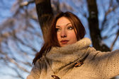 Winter portrait of young woman in the winter scenery. — Stock Photo