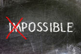 Impossible and possible option handwritten with white chalk on a blackboard. — Stock Photo