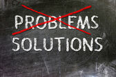 Problem and Solutions option handwritten with white chalk on a blackboard. — Stok fotoğraf