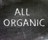 All Organic handwritten with white chalk on a blackboard. — Stock Photo