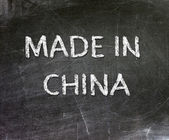 Made in China handwritten with white chalk on a blackboard. — Stock Photo