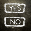 Yes or no written on the blackboard with white chalk. Your choice as a concept. — Stock Photo #19401977