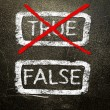 True or false written on a blackboard with white chalk. — Stock Photo #19402201