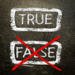 True or false written on a blackboard with white chalk. — Stock Photo