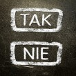 Tak or nie written on the blackboard with white chalk. Your choice as a concept. — Stock Photo #19402323