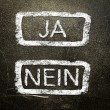 Ja or nein written on the blackboard with white chalk. Your choice as a concept. — Stock Photo #19402429
