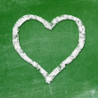 Love heart symbol on a blackboard — Stockfoto