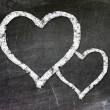 Love heart symbol on a blackboard — Stock Photo #23418928