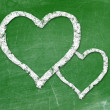 Love heart symbol on a blackboard — Stock Photo #23418946