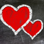 Love heart symbol on a blackboard — Stock Photo #23418962