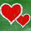 Love heart symbol on a blackboard — Stock Photo #23418988