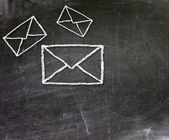 E-mail symbol drawn with chalk on blackboard — Stock Photo