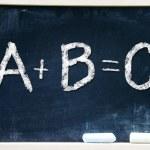 ABC handwritten chalk on a blackboard — Stock Photo #23665793