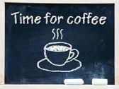Hot coffee writen on a chalkboard — Stock Photo