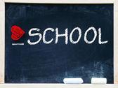 I love school phrase handwritten on blackboard — Stock Photo