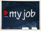 I love my job handwritten with white chalk on a blackboard. — Foto Stock