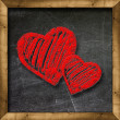 Red heart drawn on a blackboard — Stock Photo