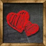 Red heart drawn on a blackboard — Stock Photo