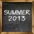 Summer 2013 handwritten on blackboard - Stock Photo