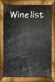 Wine list written with white chalk on a blackboard — Stock Photo