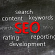 Seo with words over black background — Stock Photo