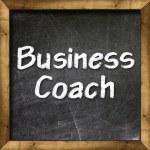 Business Coach handwritten with white chalk on a blackboard — Stock Photo #27382183