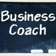 Business Coach handwritten with white chalk on a blackboard — Stock Photo
