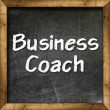 Business Coach handwritten with white chalk on a blackboard — Stock Photo #27382183