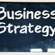 Business strategy handwritten with white chalk on a blackboard. — Stock Photo #27639011