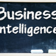 Business Intelligence handwritten with white chalk on a blackboard — Stock Photo #27639029