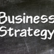 Business strategy handwritten with white chalk on a blackboard. — Stock Photo #27639043