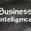 Business Intelligence handwritten with white chalk on a blackboard — Stock Photo #27639073