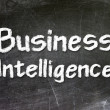 Business Intelligence handwritten with white chalk on a blackboard — Stock Photo