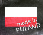 Made in Poland handwritten with white chalk on a blackboard. — Stock Photo