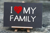 I love my family handwritten with white chalk on a blackboard. — Stock Photo