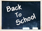 Back to school on blackboard chalkboard — Stock Photo