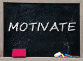 Motivate handwritten with white chalk — Stock Photo